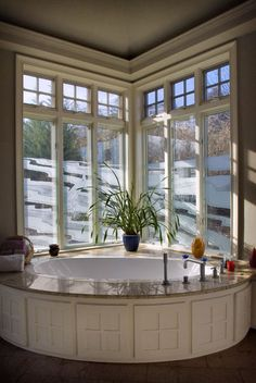 great window in this gorgeous bathroom. better have some great insulation for the winter though...