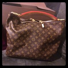 """LV Sully Monogramed Handbag Sully Handbag. Used a handful of times. Has a pen mark on the handle. I've never tried to remove the stain, but have been told it should come out with professional treatment. Also after inspecting it fully, has a pen mark on corner of inside. I didn't notice it until I took a flashlight to the bag. Serial #SD2142. Other tag says """"made in U.S.A. of imported materials"""". Have the receipt and dust bag. Please ask if you have any questions. Price firm, serious offers…"""