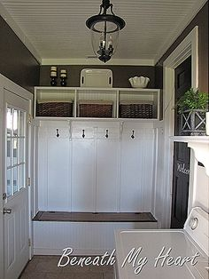 shelves with baskets, hooks on mdf, bench seat and black door