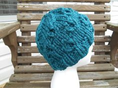 Knit this cozy cabled hat with Lion Brand Hometown USA! Get the free pattern by Knitting with Schnapps!