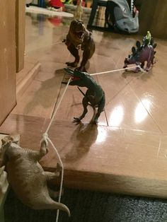 Dinovember Helping a fellow dino up the stairs - I am thinking through the stairs (not up them)