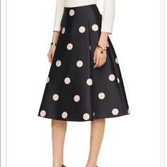 """Kate Spade Lysa Skirt Gorgeous A line skirt that has never been worn spotlight lysa skirt pairs well with a sweet cardigan during the day, or a slightly cropped top after-hours. • 100% Polyester • size 4 measures 28"""" from top to bottom • dry clean only • Navy with pale pink dots • kate spade Skirts A-Line or Full"""