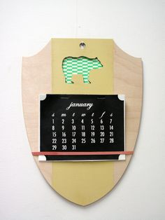 Crest Calendar! How adorable is this idea and when the year is over you can make a new calendar or use it for photos, recipes, receipts, or anything!