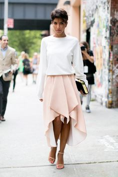 A floaty pink skirt looks fresh when paired with a basic white long-sleeve tee.