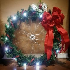 Upcycled bicycle wheel I made into a Christmas wreath. Homemade Christmas Wreaths, Christmas Door Wreaths, Outdoor Christmas Decorations, Modern Christmas, Christmas Crafts, Xmas, Christmas Ornaments, Wagon Wheel Decor, Bicycle Wheel