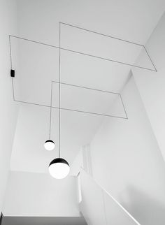 Beautiful geometry inside a vertical space. Lots of depth to this fun idea, capped off by a simple, elegant choice of light.