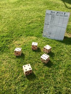 Yard Yahtzee  Such a fun and easy game to make for any outdoor event. Have a 4x4 cut into 5 pieces, sand, and use a sharpie for the numbers. I used a dry erase board and sharpie for the score board and dry erase markers for the players or teams to enter their score. That way the scores can be easily erased while the card remains the same. Perfect for backyard BBQs, birthdays, graduations, or 4th of July.