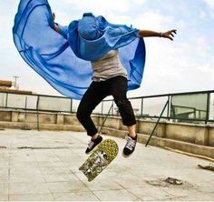 I love this picture, it's like the skateboarder is breaking out of the restrictions her burka opposes on her