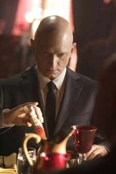 "Michael Cerveris as the Observer ""September"" in Fringe - I have a theory on why all the Observers crave intensely hot/spicy food (ie. Once September ordered a sandwich and doused it with a great deal of tabasco sauce, a LOT of black pepper and 11 large raw jalapeno slices)....Anyway, I think that they crave the spicy food because it helps them to FEEL....for them to feel anything would be a great gift."