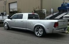 "New Dodge Mega Cab stretched with an 8ft bed & 26"" rims."