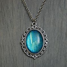 This antiqued silver necklace was created using one of my hand painted color shifting 'stones'. Set in antique silver. The color Endless Deep