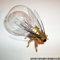 Steampunk brooch Large Brass Fly Lightbulb Brooch Unique Steampunk... ($25) ❤ liked on Polyvore featuring jewelry, brooches, vintage charm, brass charms, vintage antique jewelry, vintage jewelry and antique jewelry