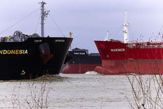 Three Ships Bows on the Mississippi River south of New Orleans