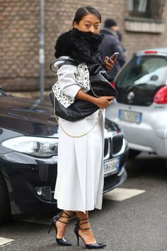 Margaret Zhang put her spin on ladylike with cool-girl black and white. Milan Fashion Week Fall 2014 Street Style