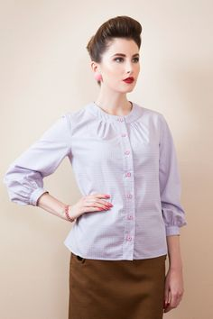 RECOLLECTION continues to channel the mid-century silhouette with a range of darling tuck-me-in blouses. Sylvia's charming take on the beloved classic shirt is made all the more special with cuffed bracelet-length sleeves and pointed back yoke detailing. A crisp little blouse in Grey and Pi