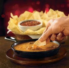Skillet Queso: Cheese dip with seasoned beef. Served with warm tostada chips and our house-made salsa. #Chilis