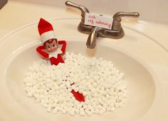 elf relaxing in a sink of marshmellows (or cotton balls too)