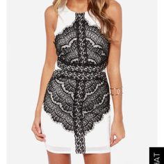White and black dress with lace Sleeveless bodycon dress. Great condition, no stains! Only worn once! Lulu's Dresses