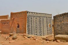 Gurunsi traditional mud house decorating; found in Burkina Faso, and in the Upper East Region of Ghana