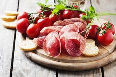 Fresh salami with tomato and bread by OxanaDenezhkina
