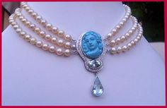 Designed by Talya D. Antique pearls, white gold. Turquoise lcameo.aquamarine and diamonds.