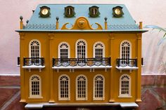 Beautiful eighteenth century architecturally inspired dollhouse.