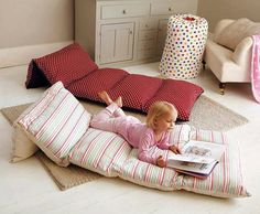 Pillow cases sewn together and stuffed with pillows make a comfy place to lay. Great for sleepovers.