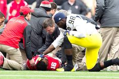 Perfect display of sportsmanship - Michigan's Devin Gardner consoles Ohio State's J. Barrett after Barrett was injured in the Ohio State/Michigan game. This is what sports should be showing, rather than trash talking and fighting. Ohio State Vs Michigan, Michigan Wolverines Football, Buckeyes Football, Ohio State University, Ohio State Buckeyes, College Football, Michigan Game, Michigan Athletics, Wisconsin Badgers