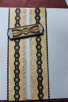 Jewel Achievements, EK tools border punch.  Twinkle chain, scallop rotary trimmer blade