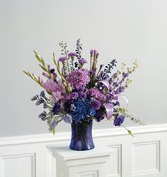 The Color of Memories Table Arrangement is just one of the many funeral floral arrangements available on Frazer Consultants' Tribute Store, an online flower store available on all Frazer-powered funeral home websites.