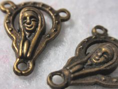These are just too cute.  Brass Rosary Connectors Smiling Mother Mary Three by TUTreasures, $3.50