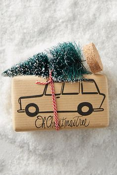 Gift wrapping. Quick pen sketch of car on kraft paper topped off with tiny christmas tree and red twine. Cute!