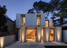 Nobbs Radford Architects designed this facade with C chunky concrete slabs alternate with deeply recessed windows on the exterior of a Sydney house extension