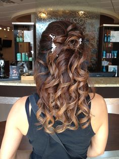 Wedding up style created by Marisa at entourage hair salon and spa in elmhurst .