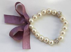 Pearl bracelet with light purple silk ribbon and by asteriasbridal, $10.00