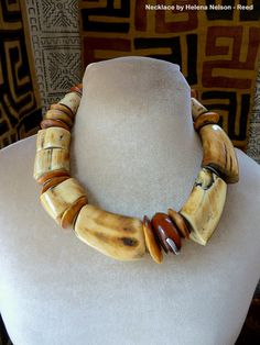 Bold Tribal Tusk and African amber resin bead by MorningDoveDesign, $645.00