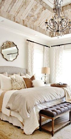 Love this bedroom. Especially the chandelier.
