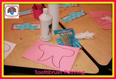 Painting with toothbrushes for Dental Health Month!