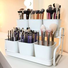 If you have a large collection of makeup brushes, store them in plant pots! It's a simple, inexpensive way to organize your beauty products!