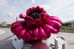 Ana Tzarev Love & Peace pink flower sculpture outside ArtScience Museum, Singapore