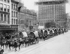 11. U.S. soldiers from Camp Custer make their way down Woodward Avenue in Detroit during a parade to encourage enlistment, circa 1917.