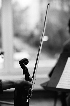 The sound of a violin is so raw, so REAL, it opens a whole realm of imagination. This picture captures the connection between the eccentric but beautiful sound of a violin and the urban world we live in.