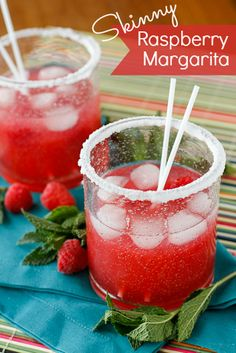 Skinny Raspberry Margarita Recipe -- this refreshing raspberry margarita is lower in calories thanks to Trop50 Raspberry Acai, perfect for a girls' night in and beyond!