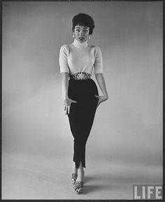 Rita Moreno in high wasted pants with cinched belt. Tiffany's fashion tip to make this look perfect:  Nothing sells 1965 like high-waisted pants cinched with a belt! Guys and gals should tuck in those button-up shirts to show off their matching belt and shoes. Rita Moreno, Slacks, Turtle Neck, Sweaters, How To Wear, Style, Fashion, Swag, Moda