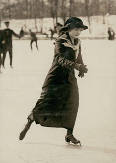 Young woman ice skater on park lake. (1915)