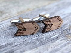Minimalist design on an arrow shaped cufflink. The pair of cufflinks feature opposing patterns, so that the two cuffs create a whole. Perfect for the lover of symmetry.  We have laser cut and hand crafted these cufflinks from 3mm thick walnut wood. The cuffs are 16mm in diameter and are finished with a strong, clear lacquer for protection.