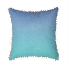 Ourlieu 'painted skies blue lagoon' pillow with white pom pom trim. Like an endless ocean with little bouncy wavelets around