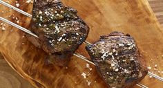 Brazilian-Style Garlic-Cilantro Steak Skewers: At churrascarias or Brazilian barbecue restaurants waiters bring long skewers of meat that have been slow-roasted over charcoal. Now it's easy. Grilling Recipes, Beef Recipes, Cooking Recipes, Hibachi Recipes, Recipies, Restaurant Barbecue, Bbq, Brazilian Style, Steak Skewers