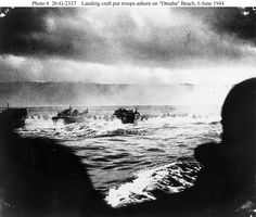 """Photo #: 26-G-2337    Normandy Invasion, June 1944    LCVP landing craft put troops ashore on """"Omaha"""" Beach on """"D-Day"""", 6 June 1944.  The LCVP at far left is from USS Samuel Chase (APA-26).    Photograph from the U.S. Coast Guard Collection in the U.S. National Archives."""
