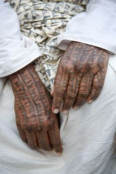 The tattooed hands of a devotee to the Hindu god Ram.